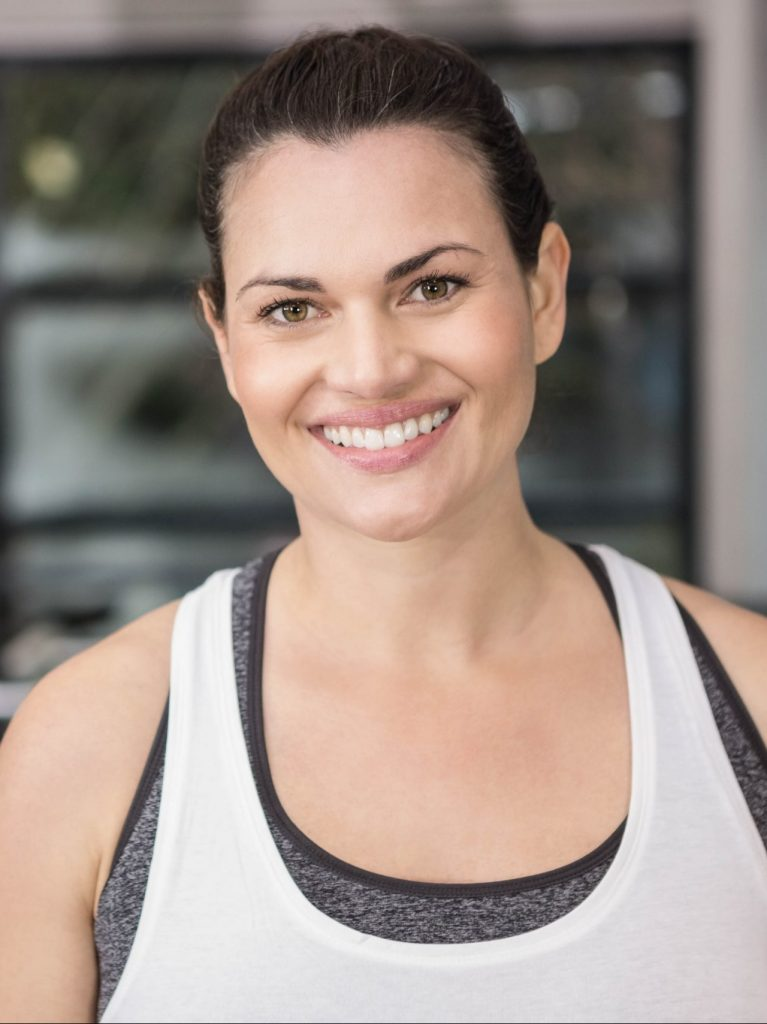 Woman In 20s Smiling At The Gym