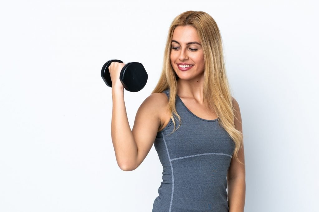 Strong-Beautiful-Young-Healthy-Woman-Flexing-With-Dumbbell
