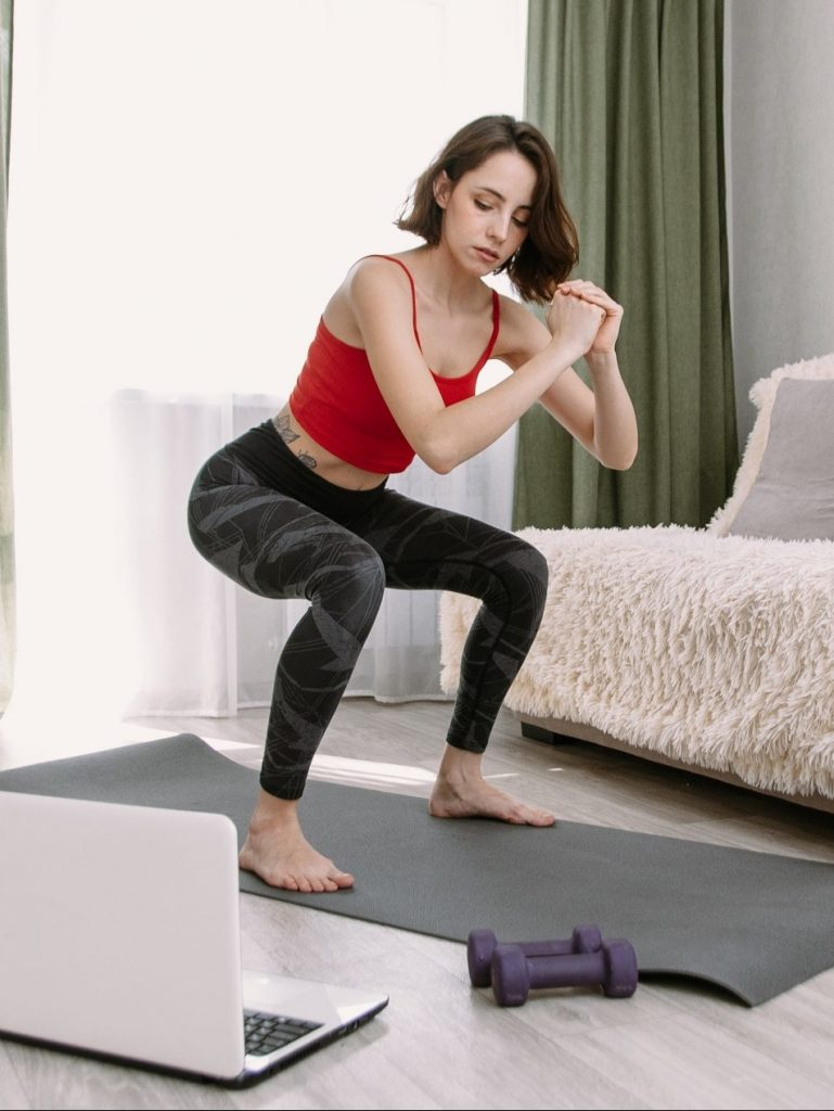 Woman Exercising At Home Via Online
