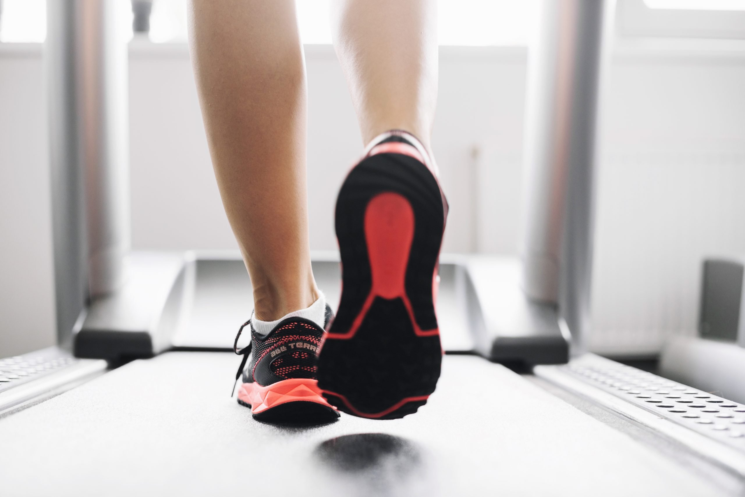 Shoes of woman running on treadmill