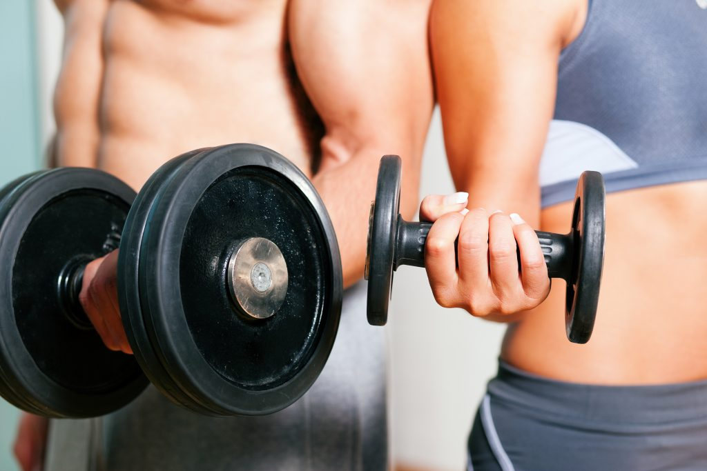 Woman and Man Bicep Curling Dumbbell