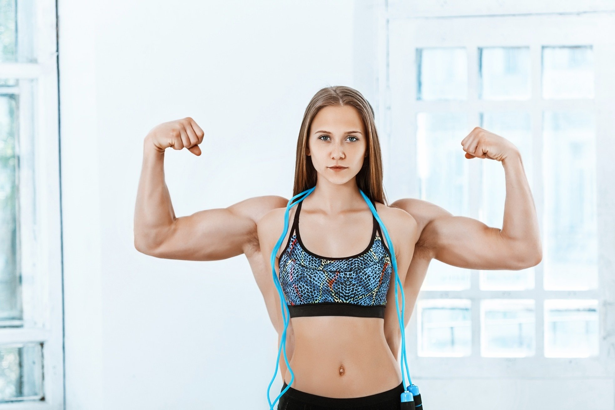 Strong Healthy Beautiful Young Woman Flexing With Male Biceps